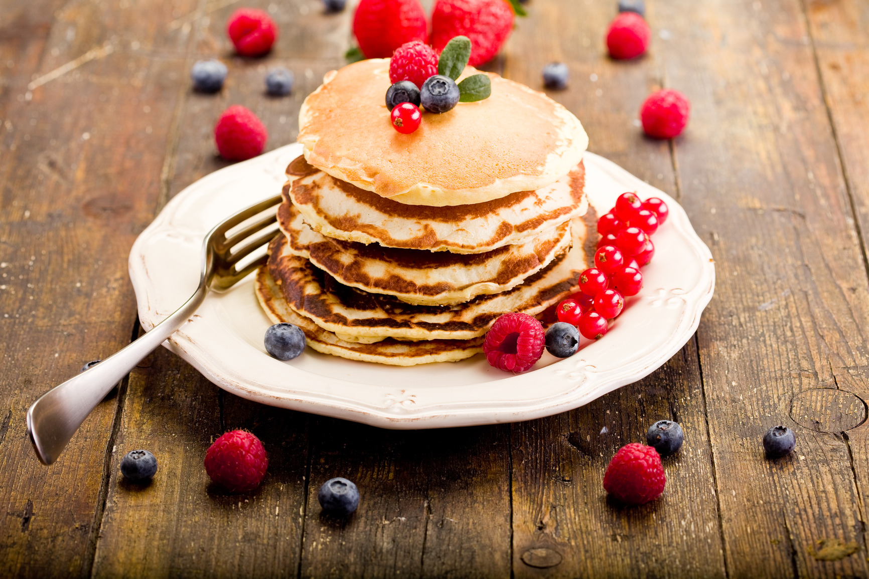 Pancakes on wooden table